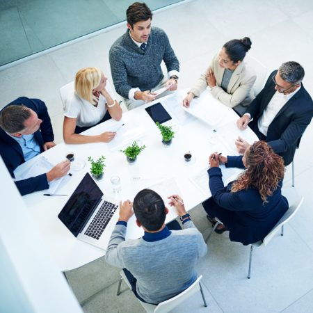 High angle shot of a group of businesspeople sitting in a meeting